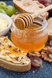 Honey, bread with butter and grape, vertical Stock Photography