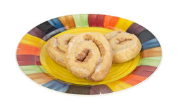 Honey buns on colorful plate Stock Images