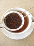 Honey bush tea in tea strainer Stock Image