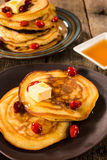 Honey and butter pancakes Royalty Free Stock Photos