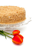 Honey cake on a beautiful glass plate Royalty Free Stock Photo