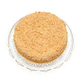 Honey cake on a beautiful glass plate Stock Photos