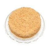 Honey cake on a beautiful glass plate Stock Photos