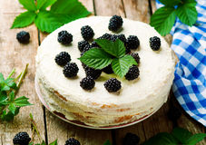 Honey cake with blackberry and whipped cream. Royalty Free Stock Images