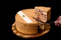 Honey cake with cherries and bee royalty free stock photos