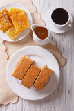 Honey cake, coffee, and honeycomb. vertical top view Royalty Free Stock Photography