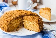 Honey cake with cream shortcakes impregnation, sweet dessert Stock Photos