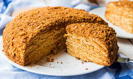 Honey cake with cream shortcakes impregnation, sweet dessert Royalty Free Stock Image