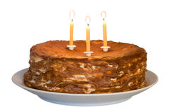 Honey cake with lighting candles Royalty Free Stock Photo