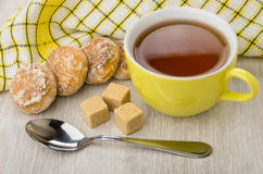 Honey-cake, lumpy sugar, teaspoon, napkin and cup of tea Stock Images