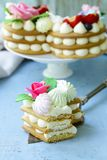 Honey cake with mascarpone cream. And decorated with flowers stock image