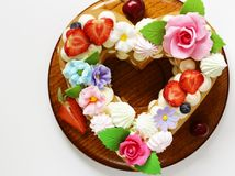 Honey cake with mascarpone cream. And decorated with flowers royalty free stock photo