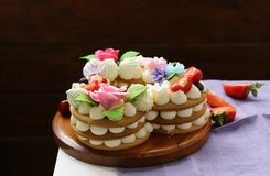 Honey cake with mascarpone cream. And decorated with flowers stock photos