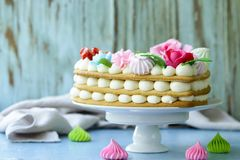 Honey cake with mascarpone cream. And decorated with flowers stock photo