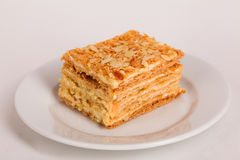 Honey cake on a plate cut  piece isolated  white background Royalty Free Stock Image
