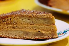 Honey cake on a plate on a yellow background stock photos