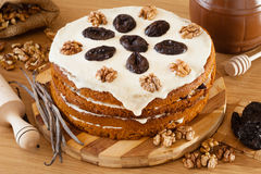 Honey cake with plum and walnut Stock Photos
