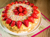 Honey cake with red strawberries Royalty Free Stock Photography