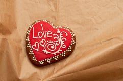 Honey-cake in shape of heart. Handmade honey-cake in shape of heart on paper, Valentines day and love concept royalty free stock photo