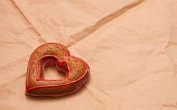 Honey-cake in shape of heart Stock Photography