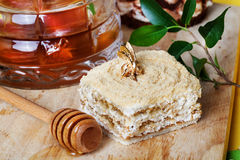 Honey cake and a special spoon in still life with Royalty Free Stock Images