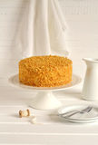 Honey cake on a stand Stock Photo