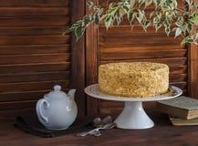 Honey cake, tea set, old books, flower Stock Image