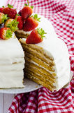 Honey cake. With white cream and strawberries Stock Photos