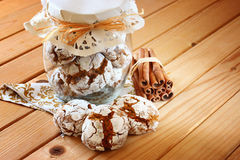 Honey cakes. cookie jar and cinnamon sticks on wooden table Stock Photos