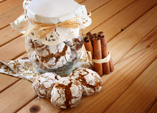 Honey cakes. cookie jar and cinnamon sticks on wooden table Royalty Free Stock Photography