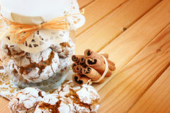 Honey cakes. cookie jar and cinnamon sticks on wooden table Royalty Free Stock Image
