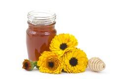 Honey and calendula flowers royalty free stock photography