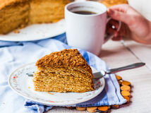 Honey caramel cake with butter cream and nuts Stock Photo