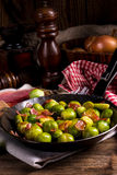 Honey caramelized brussels sprouts with ham Royalty Free Stock Photos