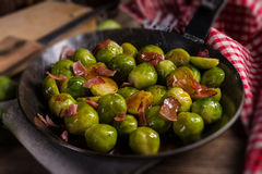 Honey caramelized brussels sprouts with ham stock photography