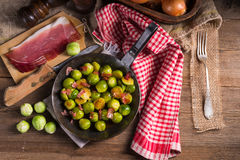 Honey caramelized brussels sprouts with ham Royalty Free Stock Images