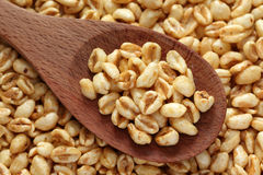 Honey cereal  in a wooden spoon. Honey Cereal (honey wheat) in a wooden spoon. Close-up Royalty Free Stock Image