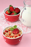Honey cereals with strawberries and milk Stock Photo