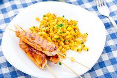 Honey chicken skewers with grilled corn salad Stock Photos