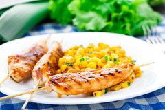 Honey chicken skewers with grilled corn salad Royalty Free Stock Photography