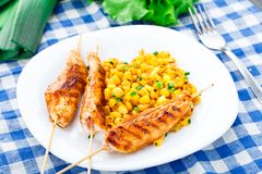Honey chicken skewers with grilled corn salad Royalty Free Stock Image