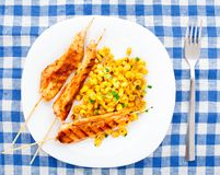 Honey chicken skewers with grilled corn salad Royalty Free Stock Photo