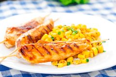 Honey chicken skewers with grilled corn salad Royalty Free Stock Photos