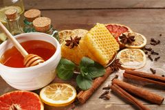 Honey, cinnamon and dried fruits on a wooden table. Healthy eating stock images