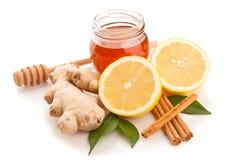 Honey, cinnamon, ginger and lemon royalty free stock image