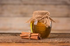 Honey and cinnamon. On a wooden background stock images