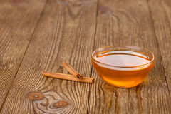 Honey and cinnamon on a wooden table Stock Photos
