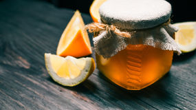 Honey and citrus fruit Stock Photography