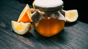 Honey and citrus fruit Stock Image