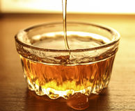 Honey close up. Honey in the vessel close up royalty free stock image